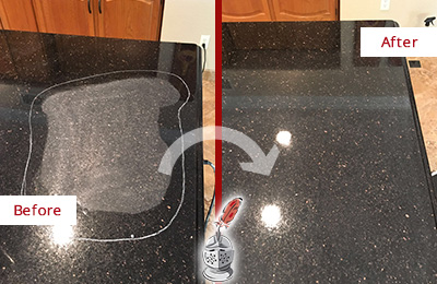 Before and After Picture of Restoration of a Black Granite Countertop with Etching